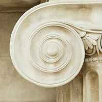 Image is a close-up of an old marble column on an official building.
