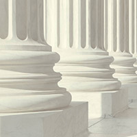 Image shows three marble columns on an official building.